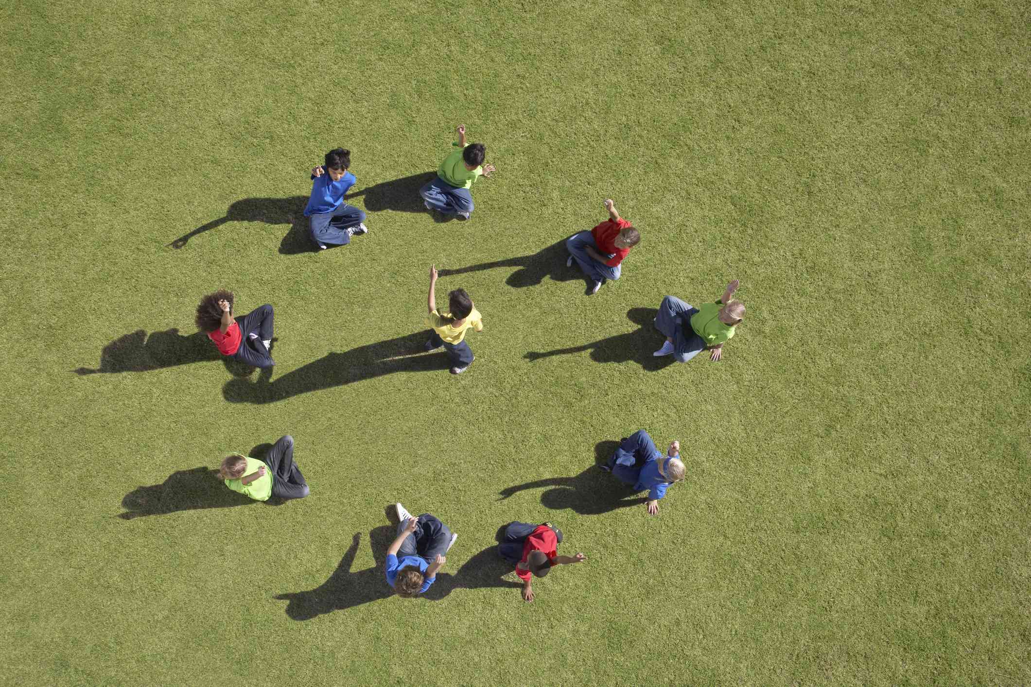 Group of children sitting in a circle playing