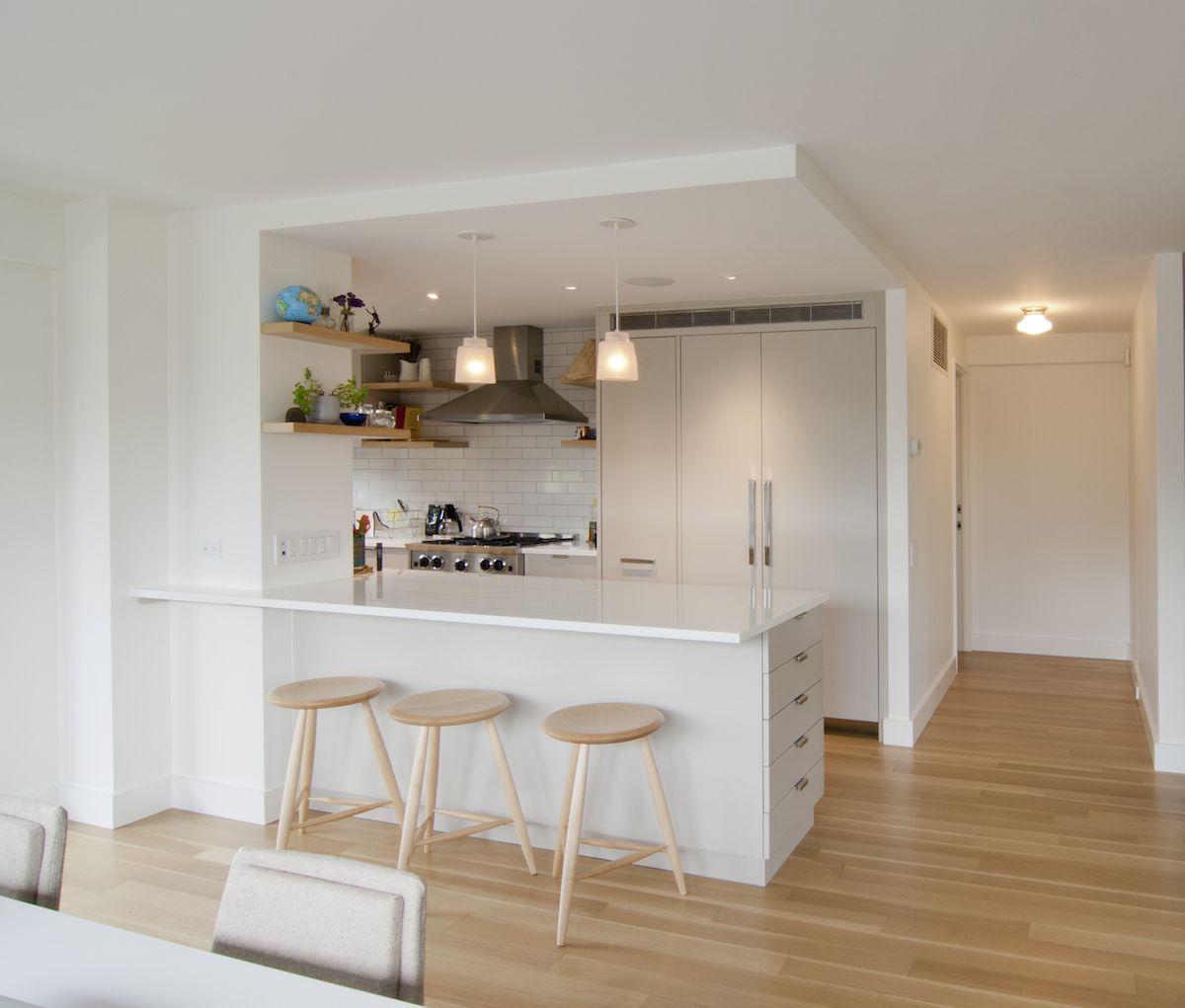white kitchen with three stools