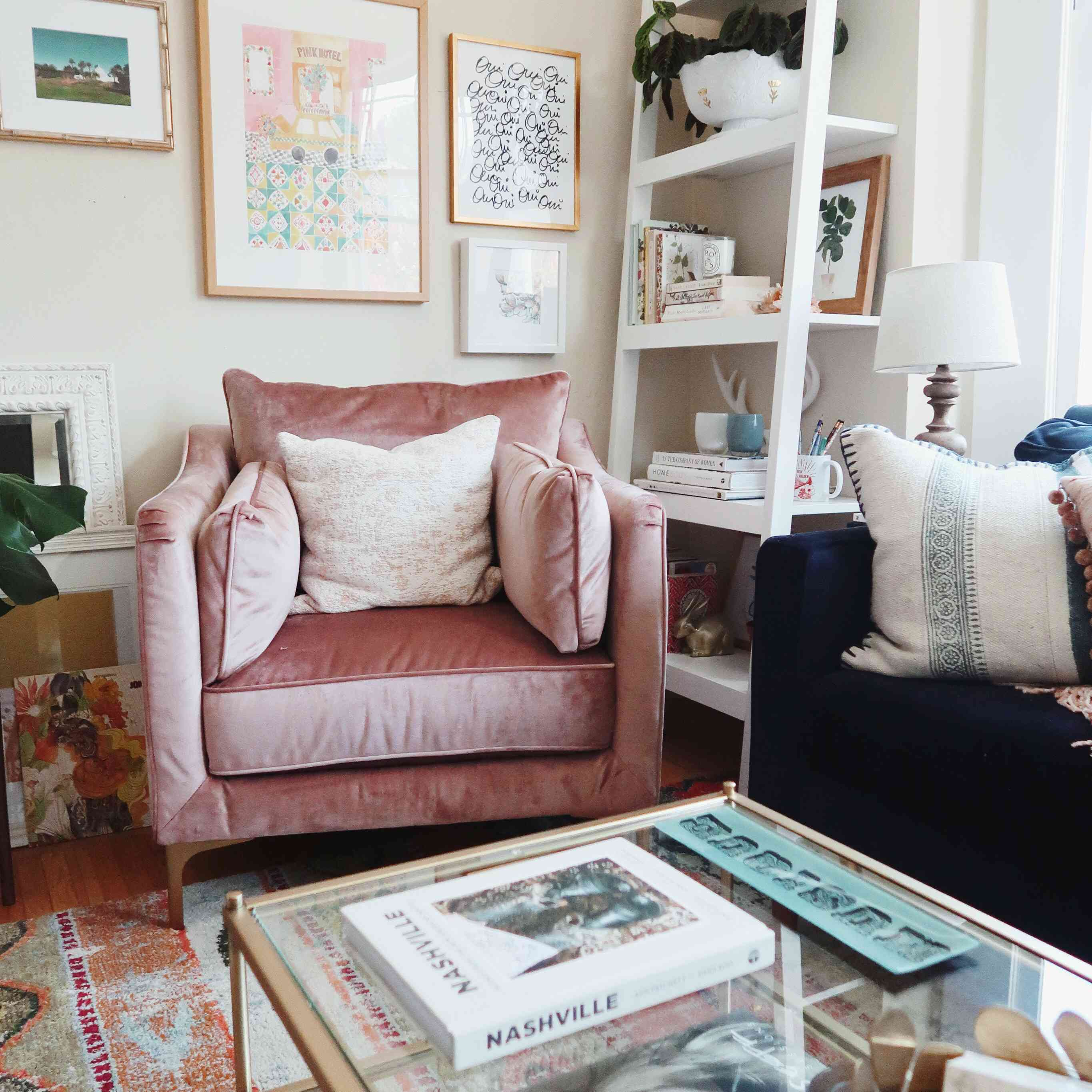Cozy living room with pink velvet armchair