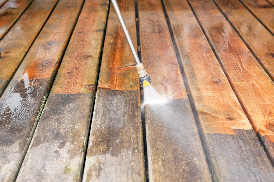 pressure water cleaning a deck