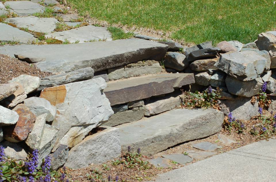 Stone steps climbing a slope.