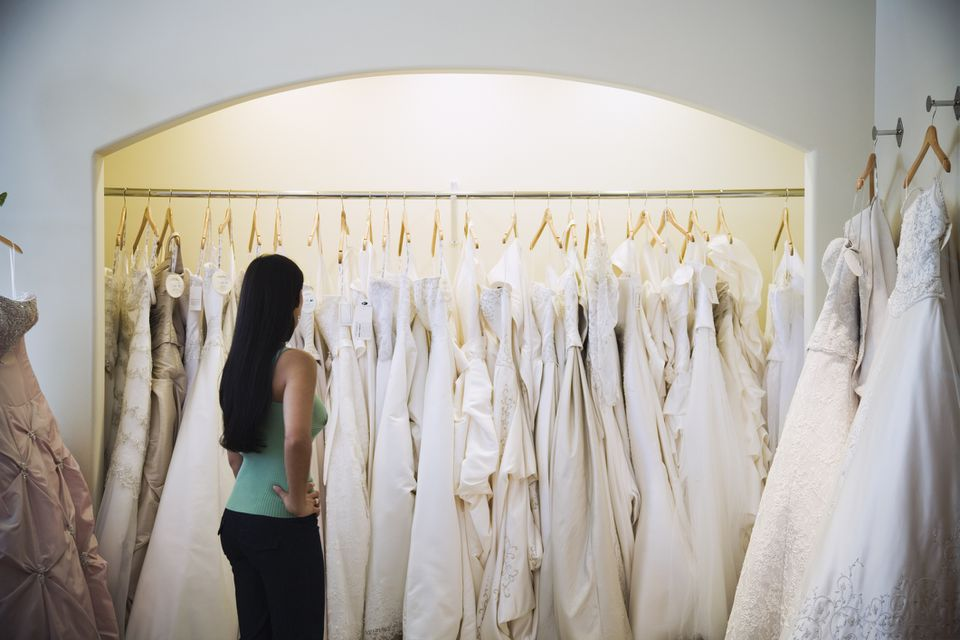 A woman looking at wedding dresses