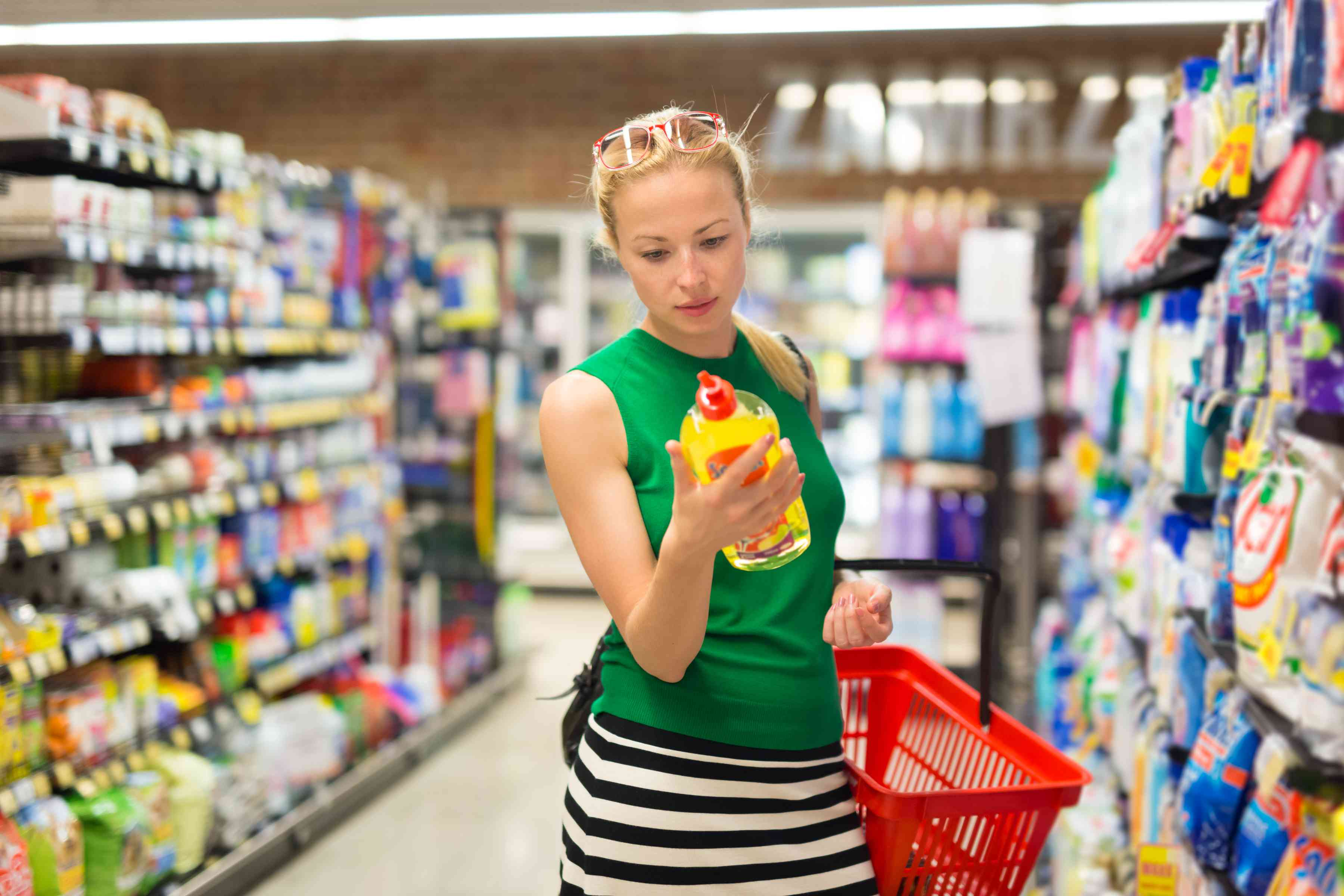Woman shopping for cleaner at the supermarket