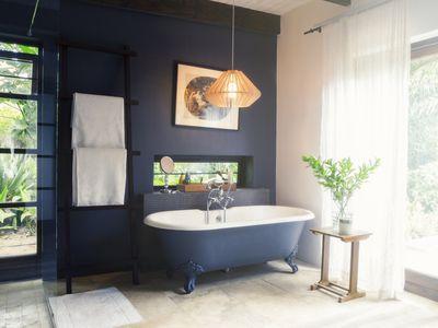 Navy bathroom wall with matching clawfoot tub