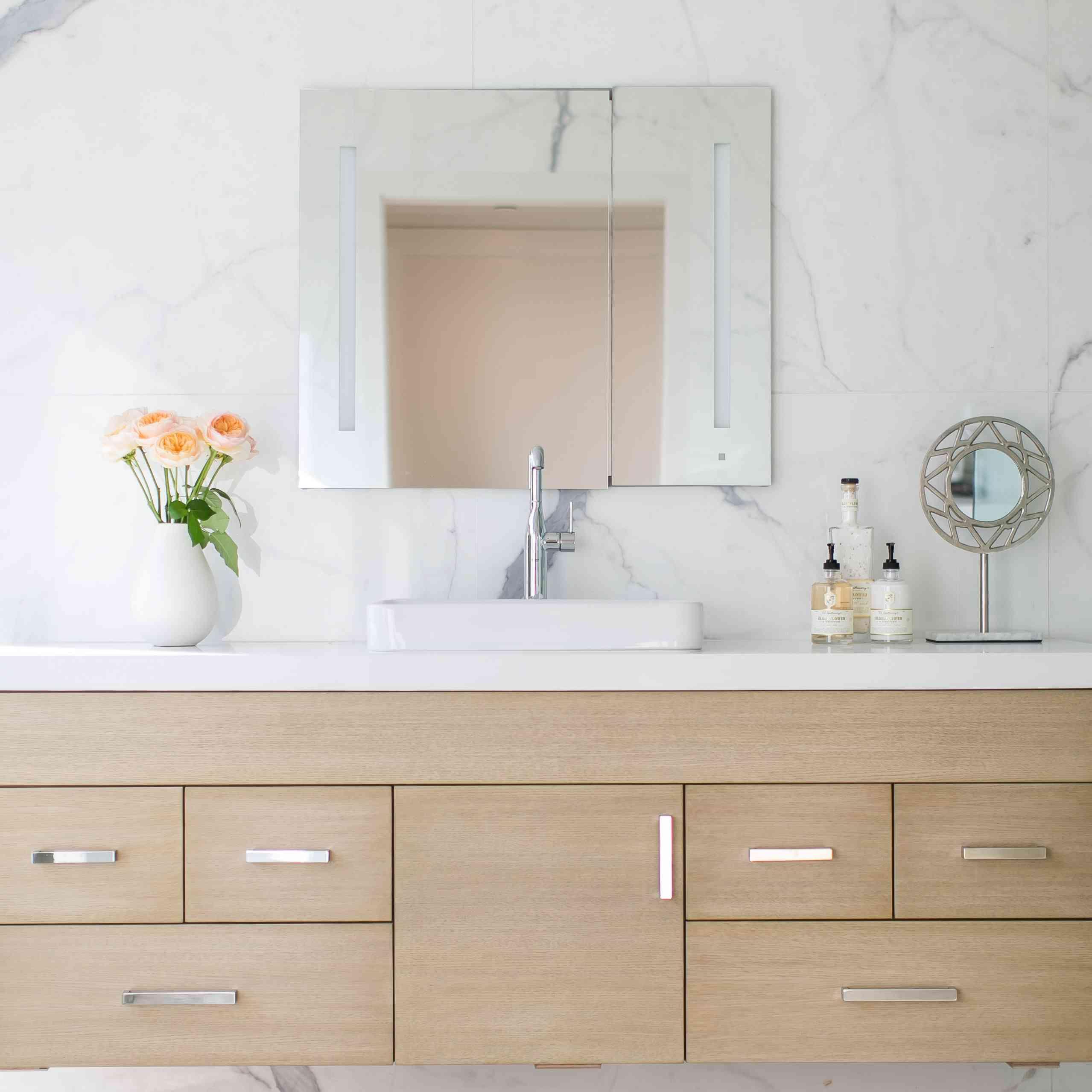 Minimalist bathroom with wood cabinets