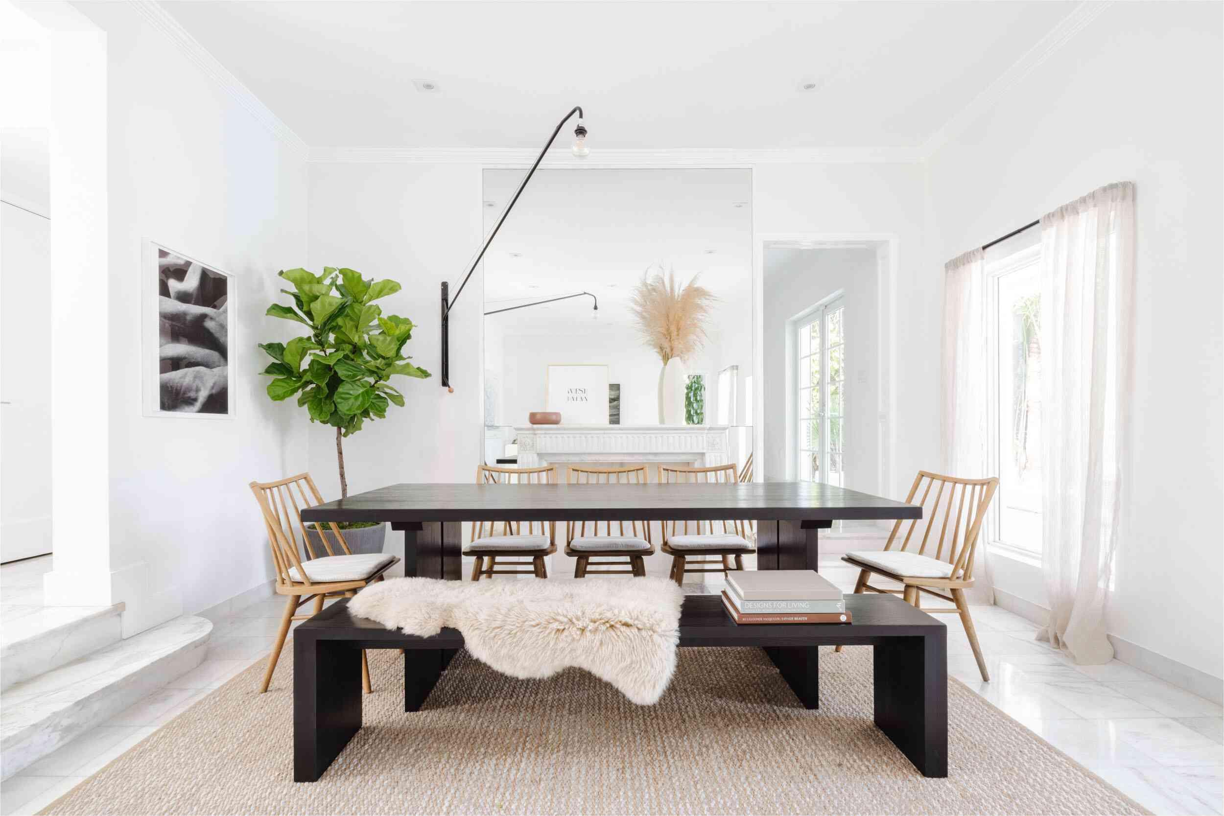 Sheepskin rug draped over a dining room bench