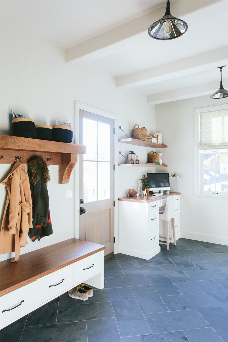 mudroom with slate floors and custom bench
