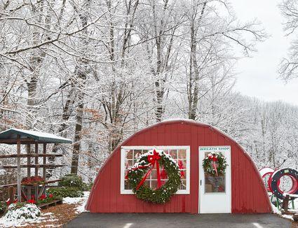 christmas wreaths hung outside a gift shop
