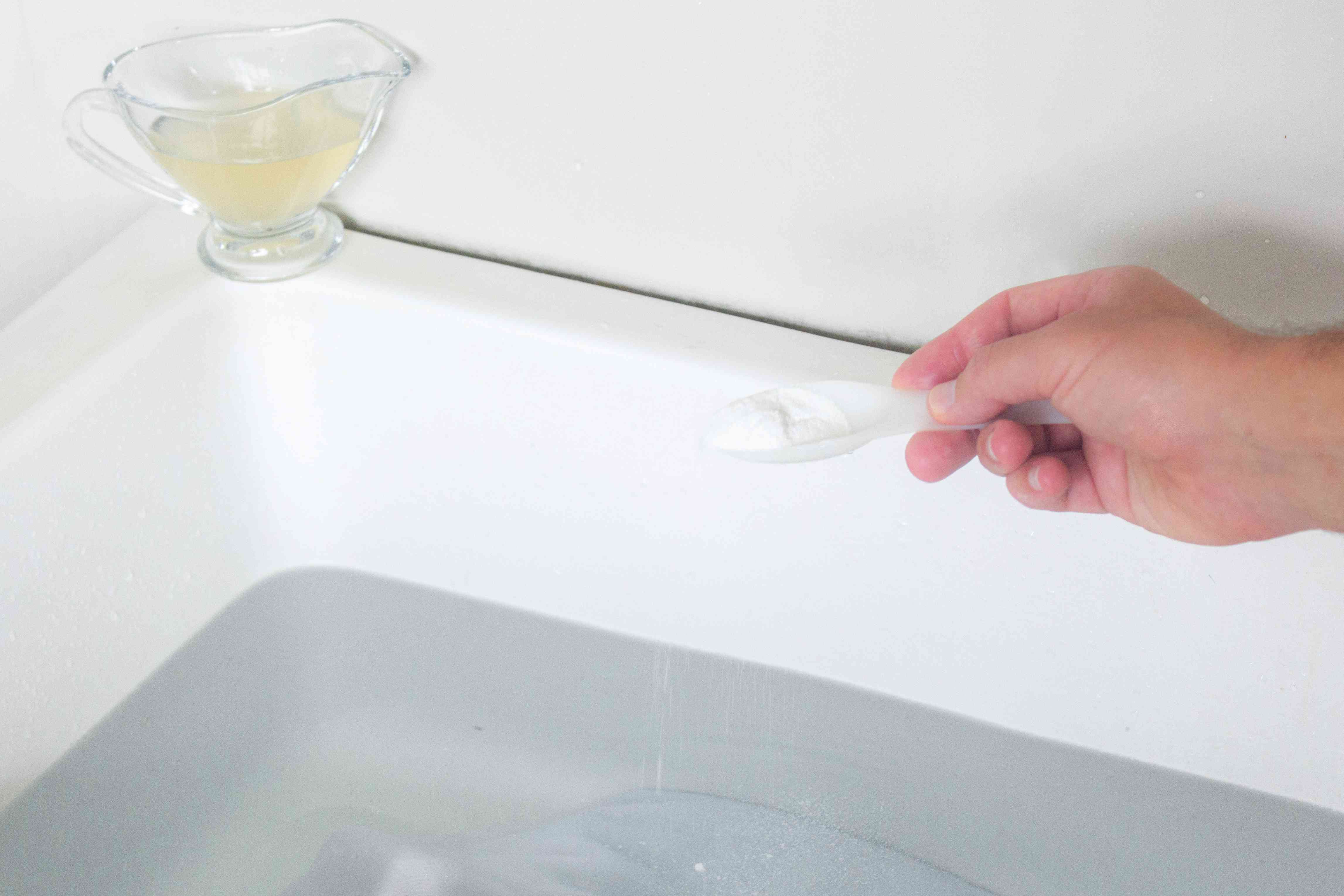 scooping oxygen bleach into a basin