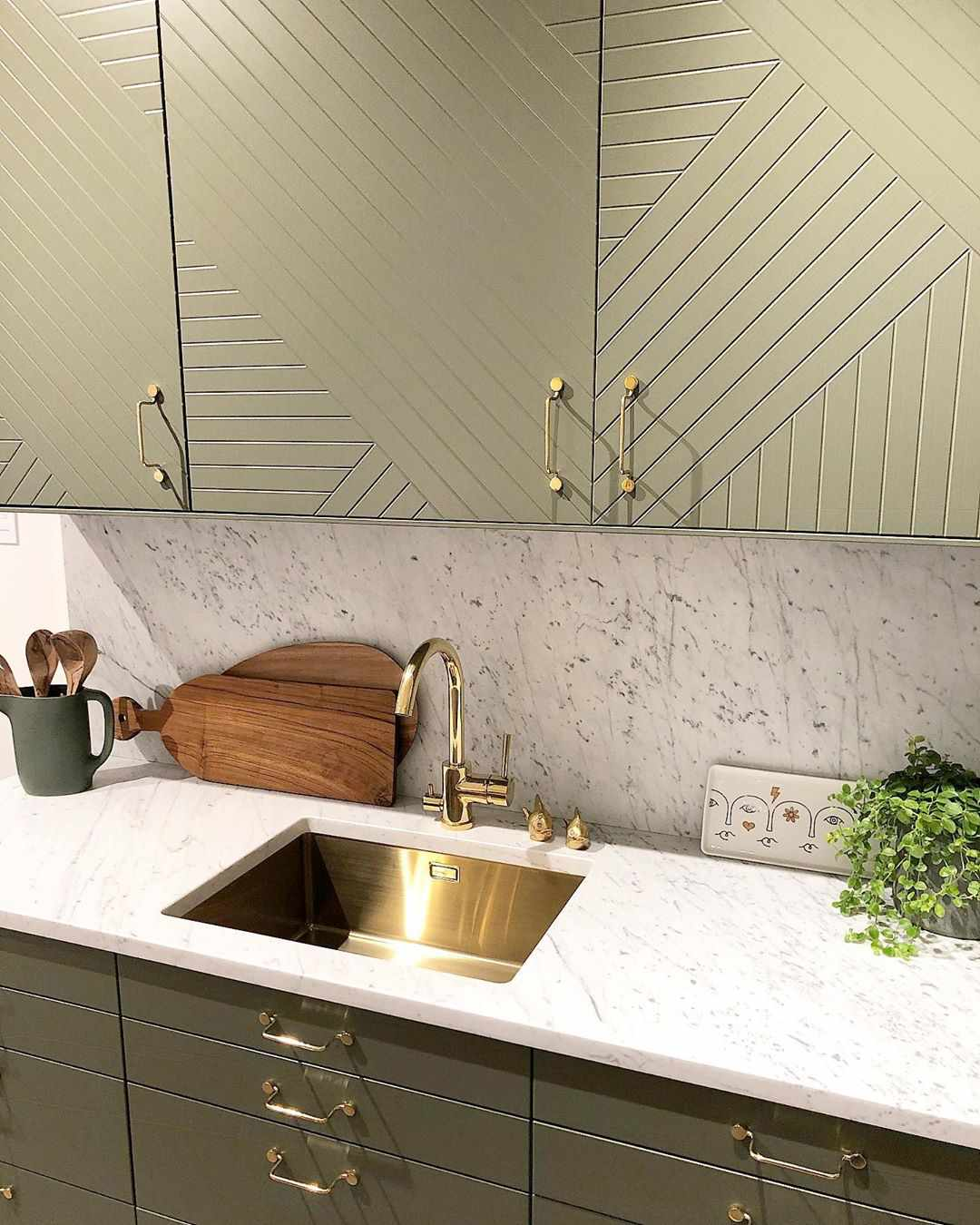 Muted green kitchen with cabinet texture