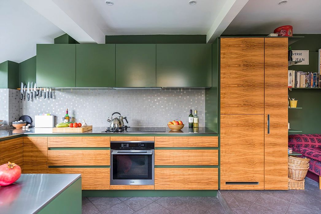 army green kitchen with wood accents