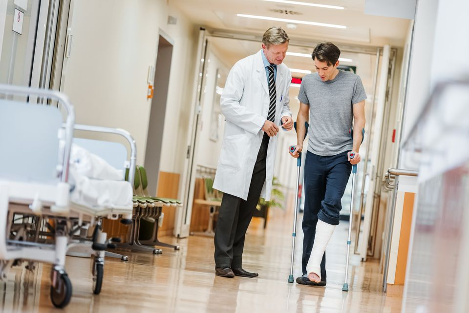 Doctor and patient walking in hospital