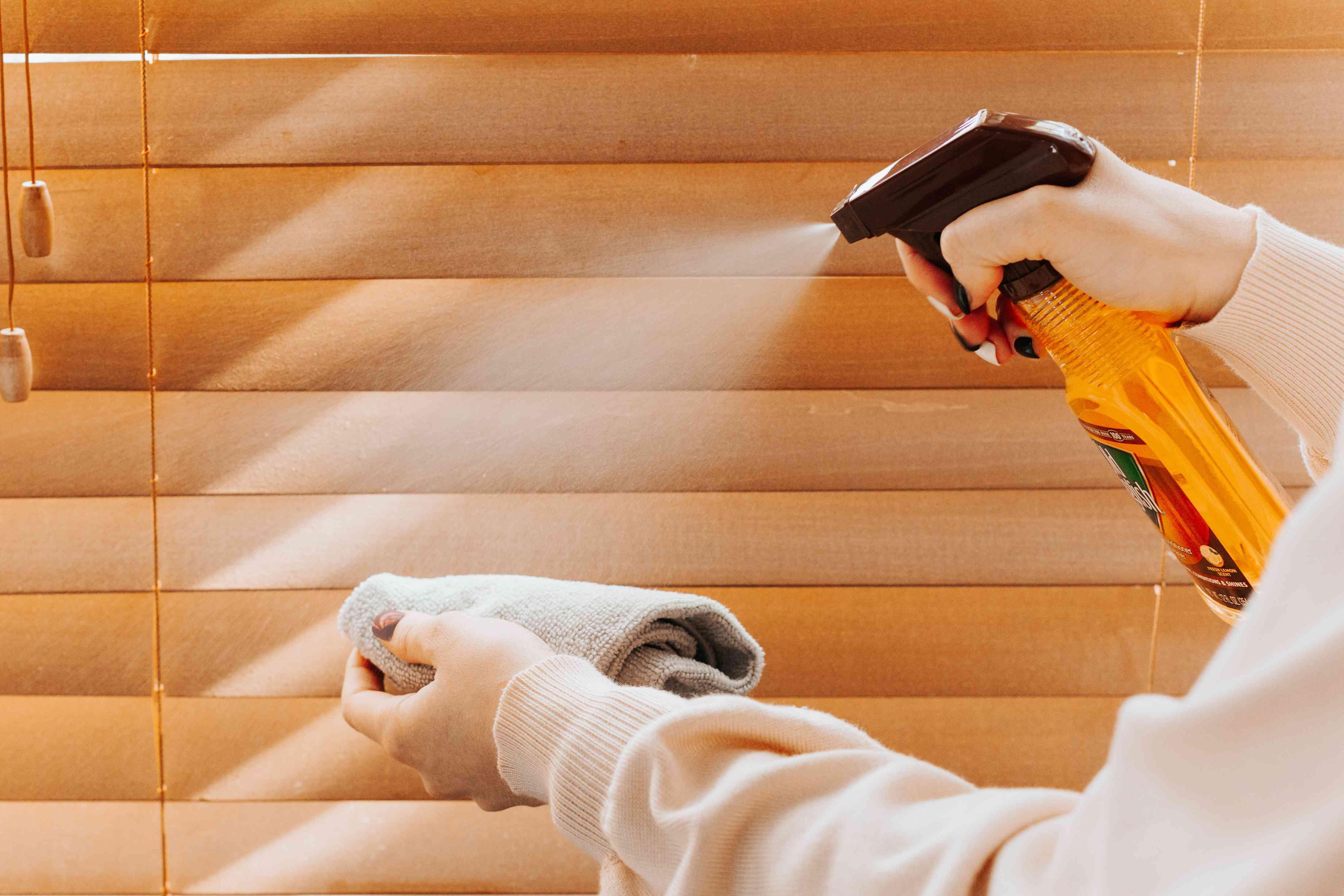 Lemon oil sprayed on wooden blinds to undo fading
