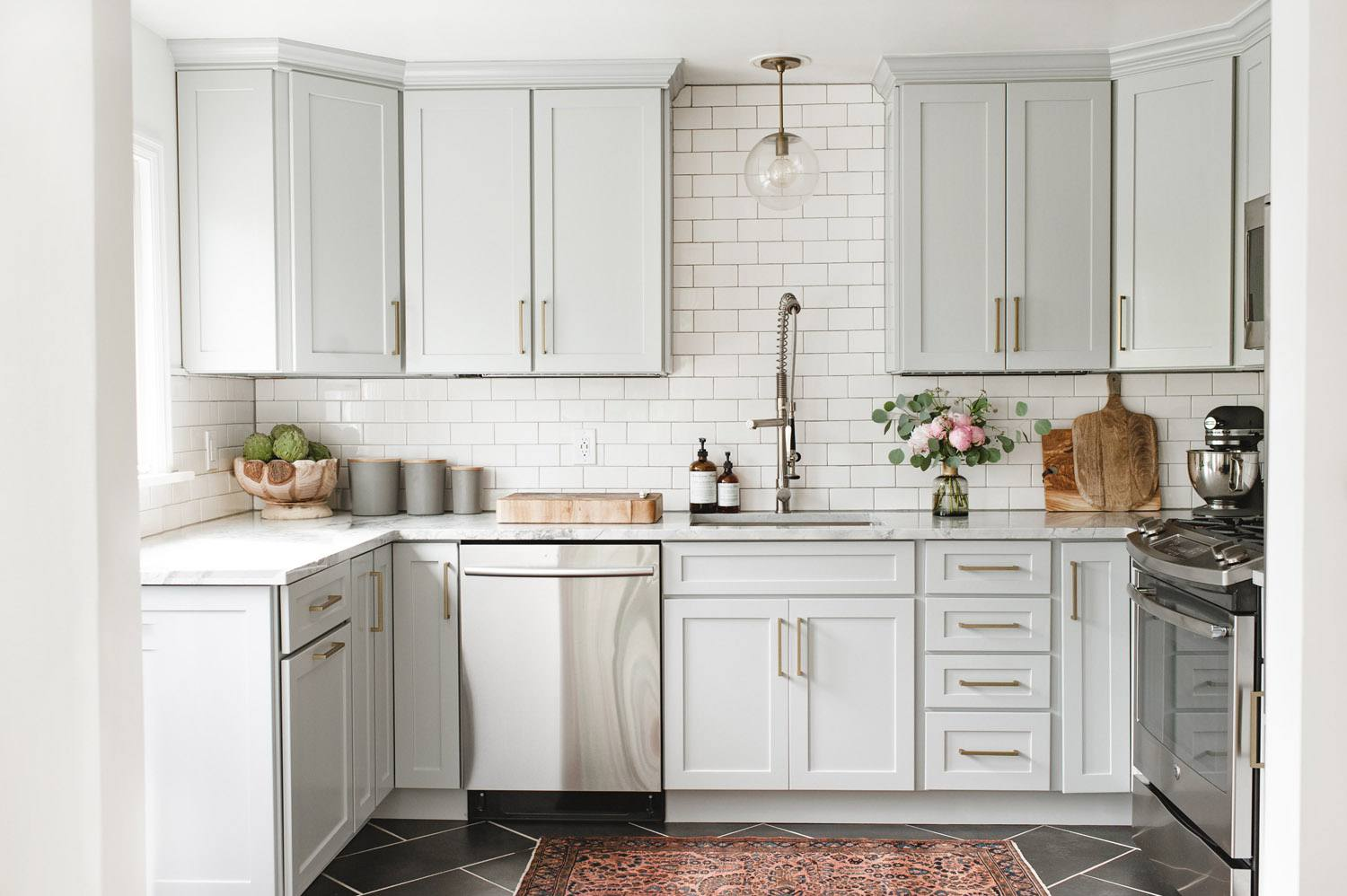 Kitchen With Subway Tile And Light Gray Cabinet