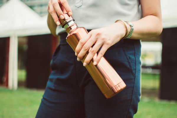 woman holding reusable water bottle