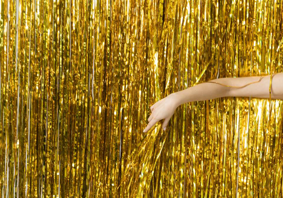 gold tinsel photo booth backdrop