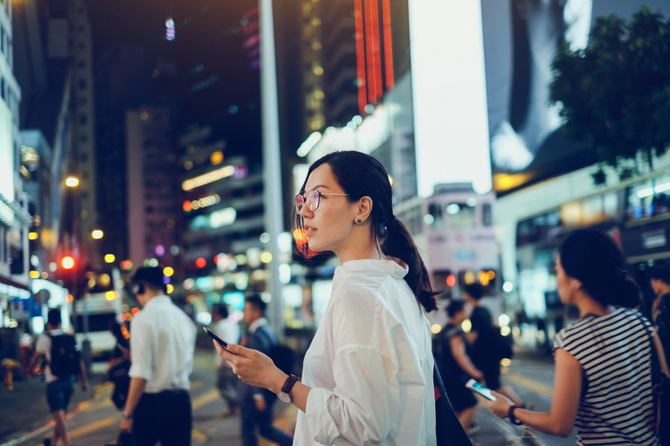 Woman using cellphone as she explores the city