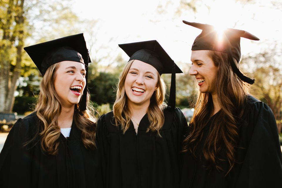 Three girls in graduation caps and gowns