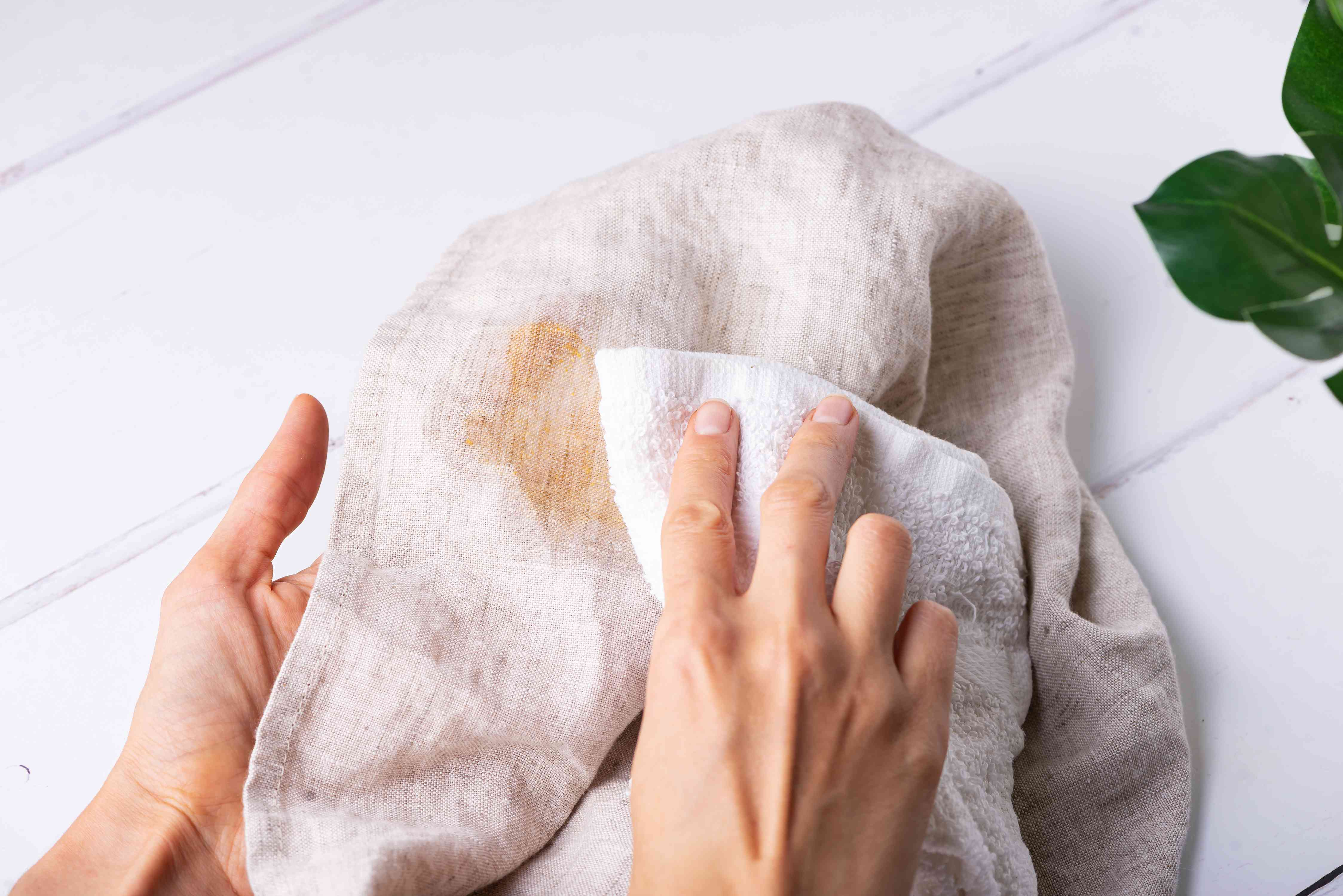 blotting the stain on the towel
