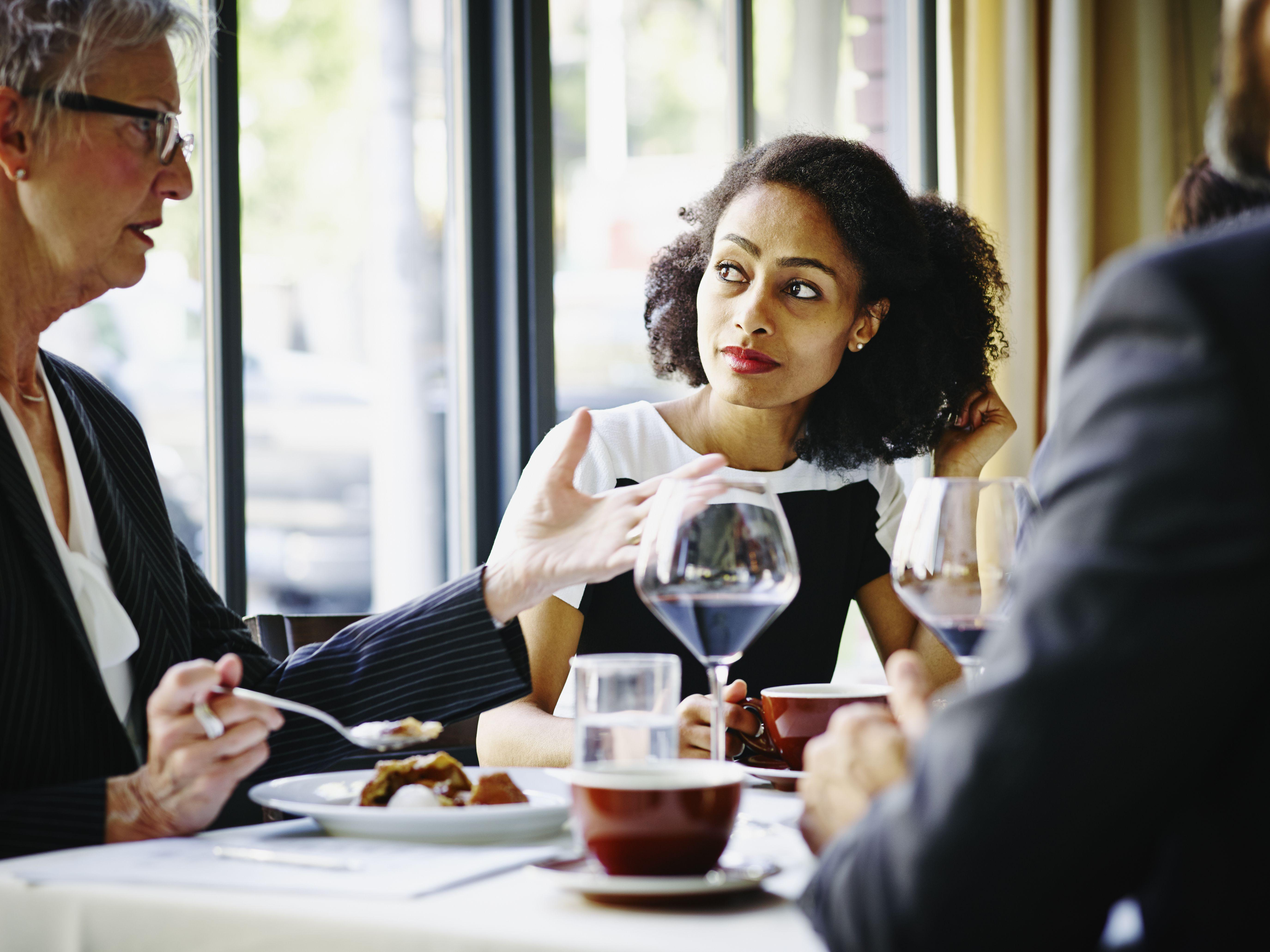 Businesswoman in restaurant listening in meeting
