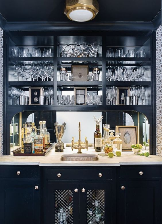 Black home bar with metallic fixtures