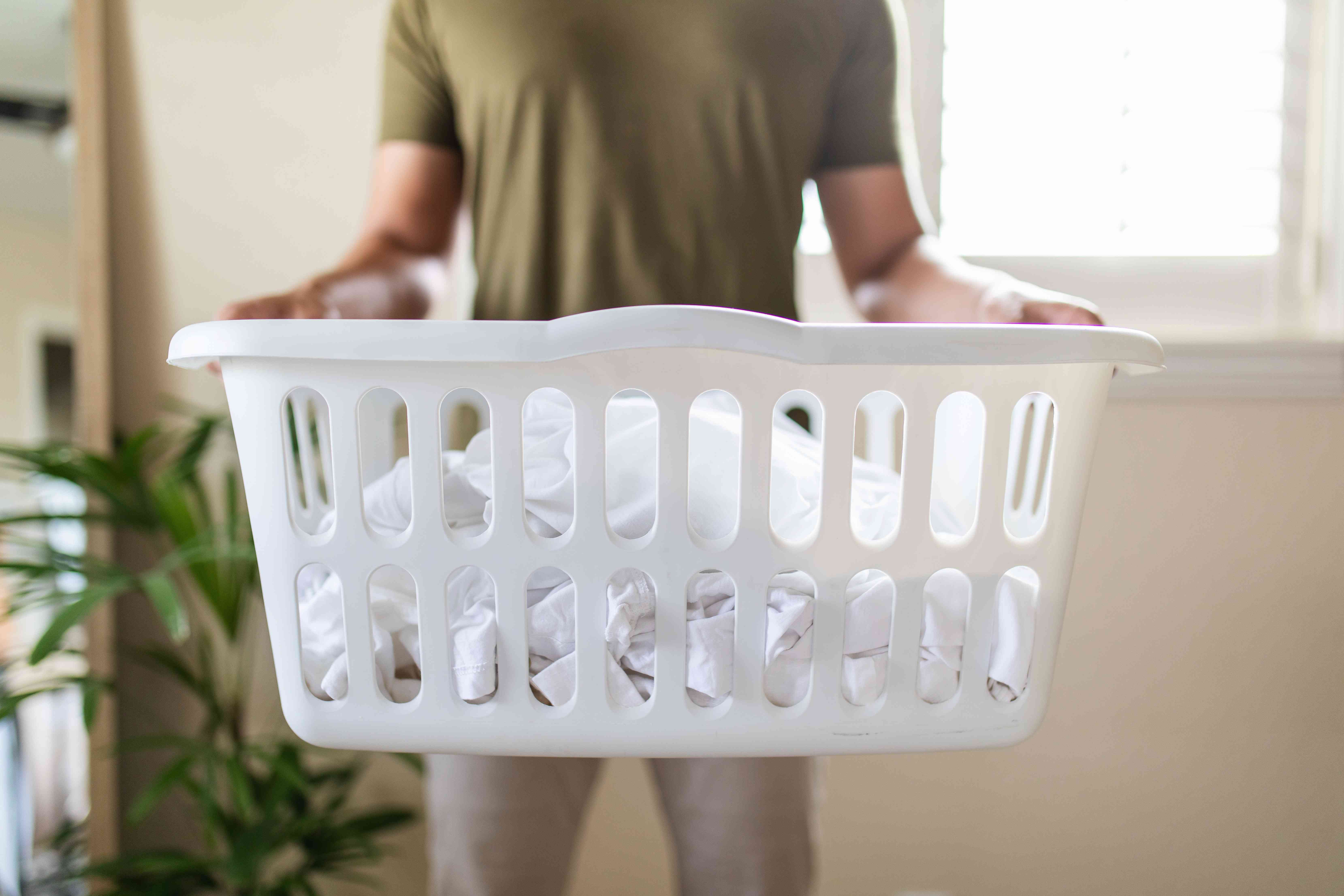 person holding a laundry basket