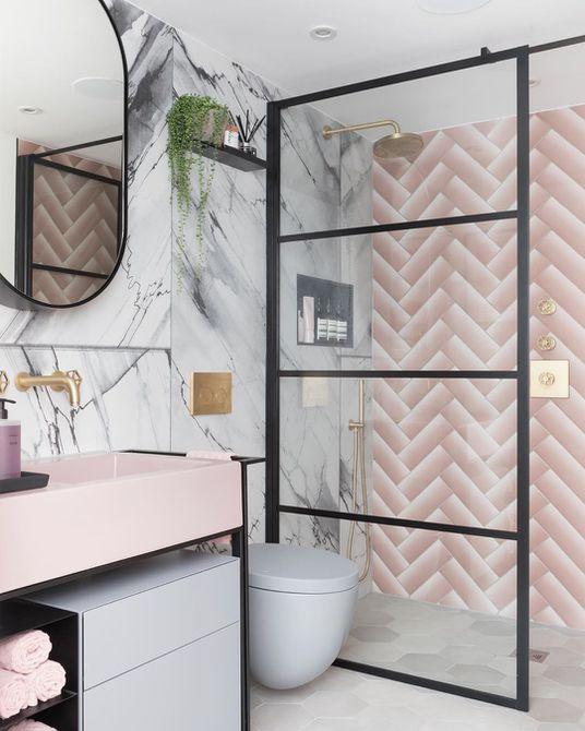 Bathroom with pink chevron tile