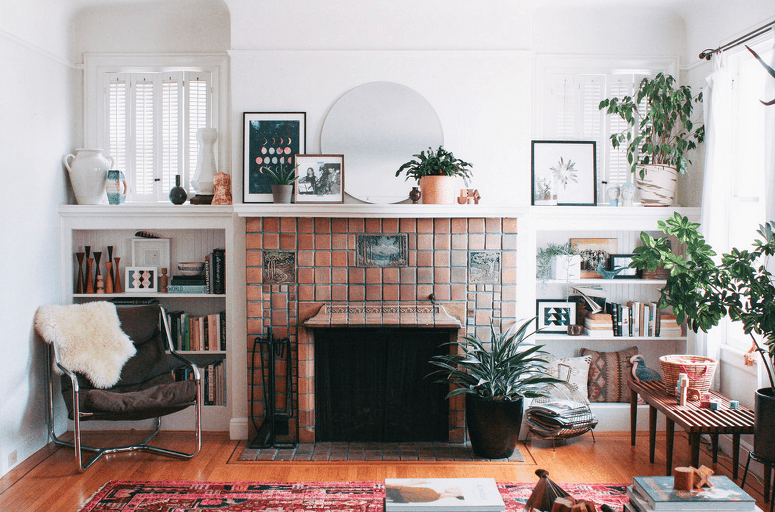 Clay tile fireplace in an airy living room