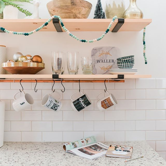 Coffee mugs hanging from hooks in kitchen