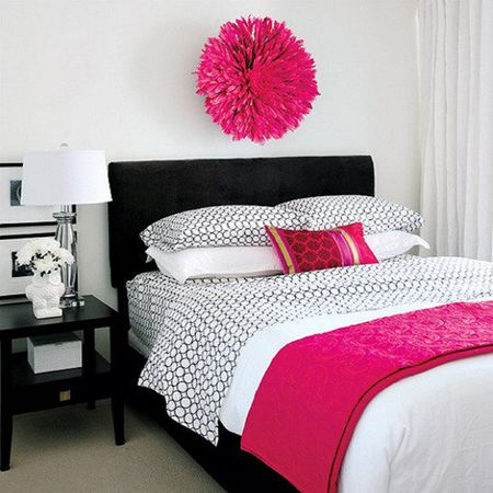 Bright Pink Accents In Black And White Bedroom