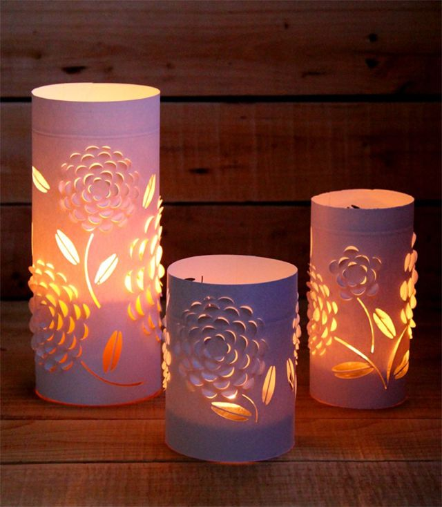 Three paper lanterns with candles inside