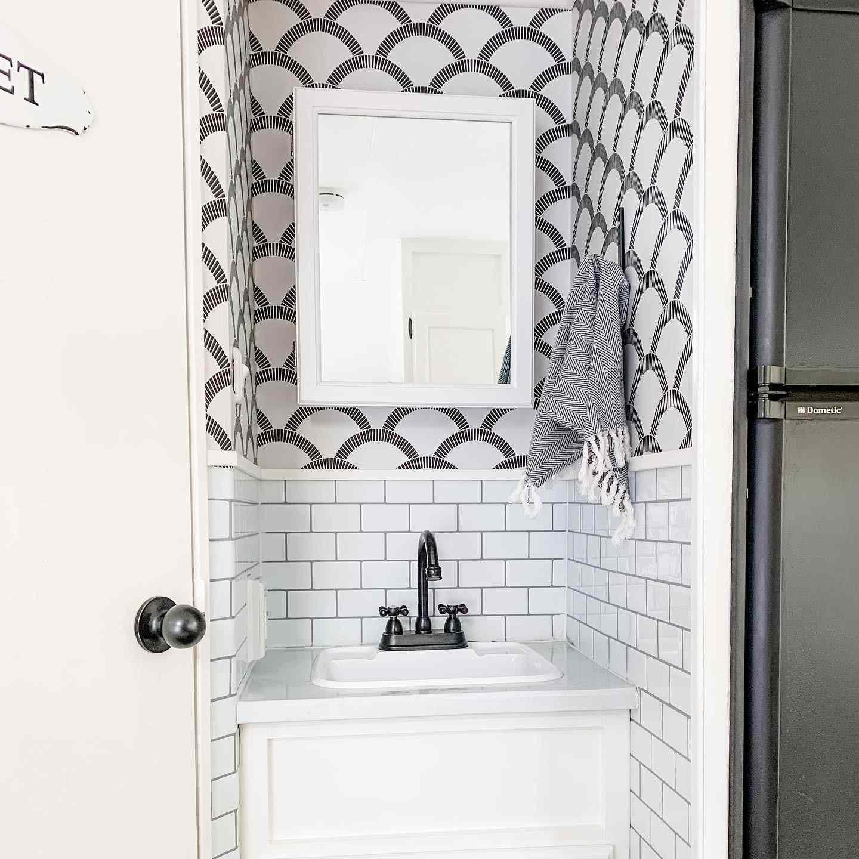 half wallpaper bathroom