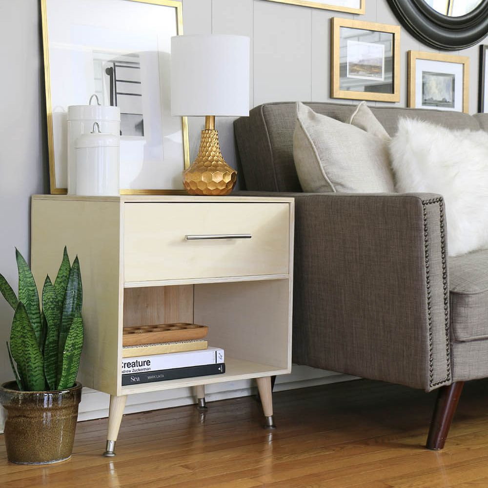 Mid-century style end table by couch