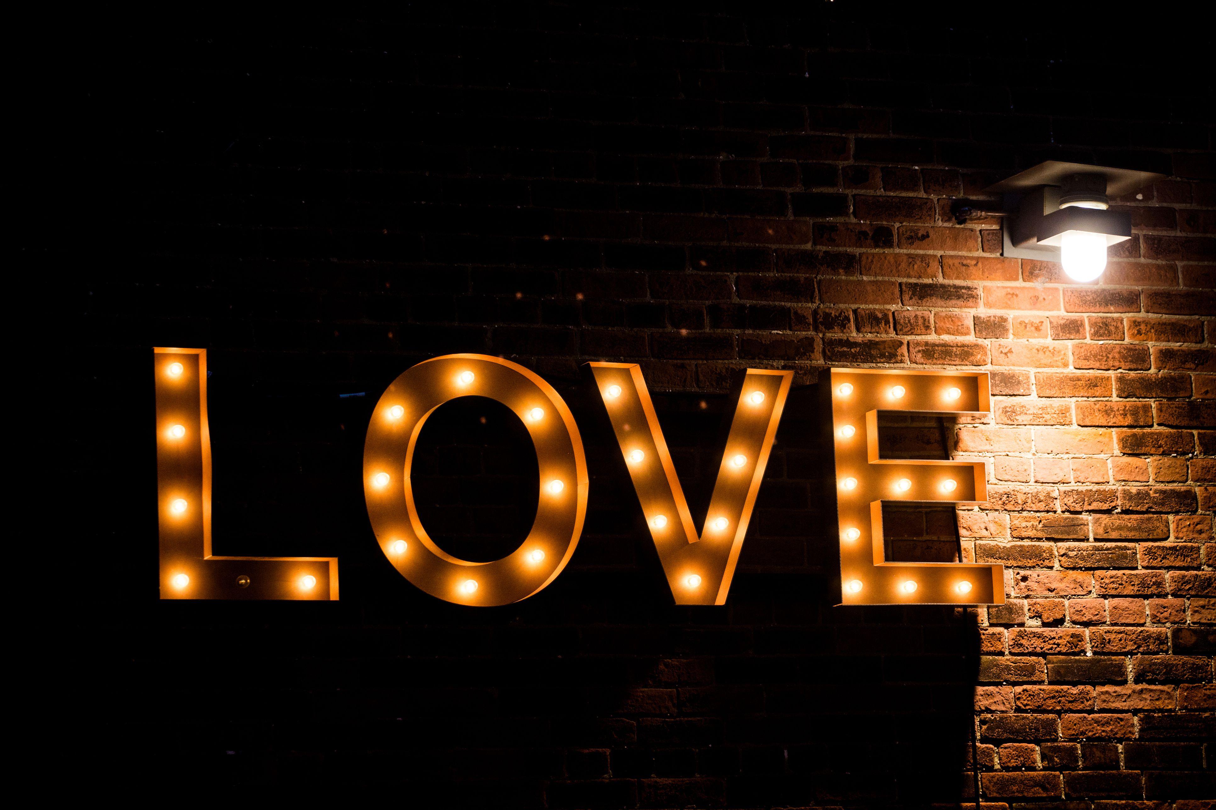 love lightbulb sign on wall