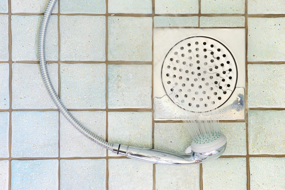 Wet bathroom floor and shower head