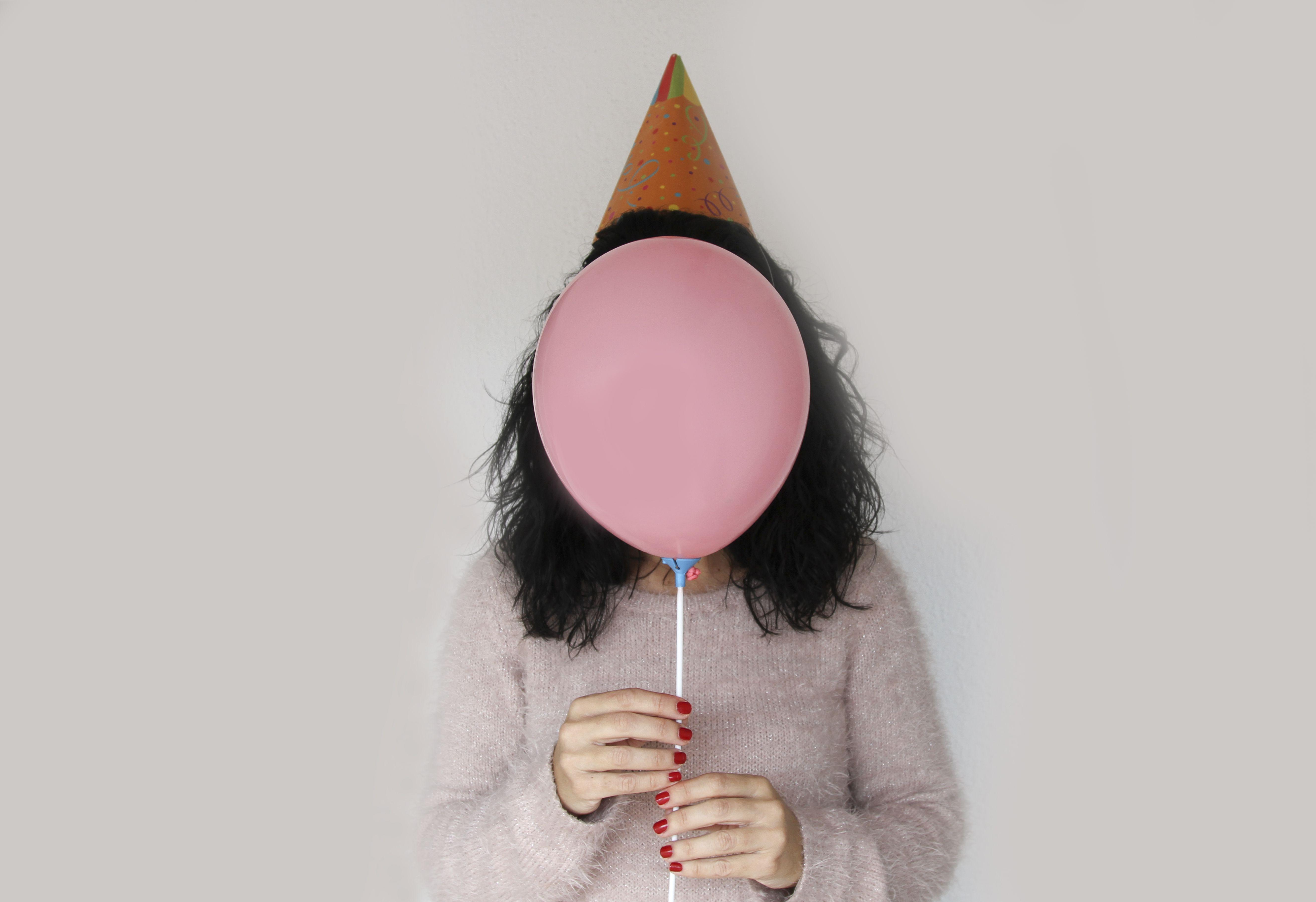 woman with balloon as face