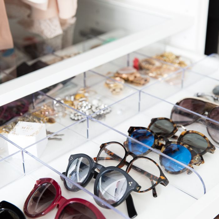 drawer with organized jewelry and sunglasses