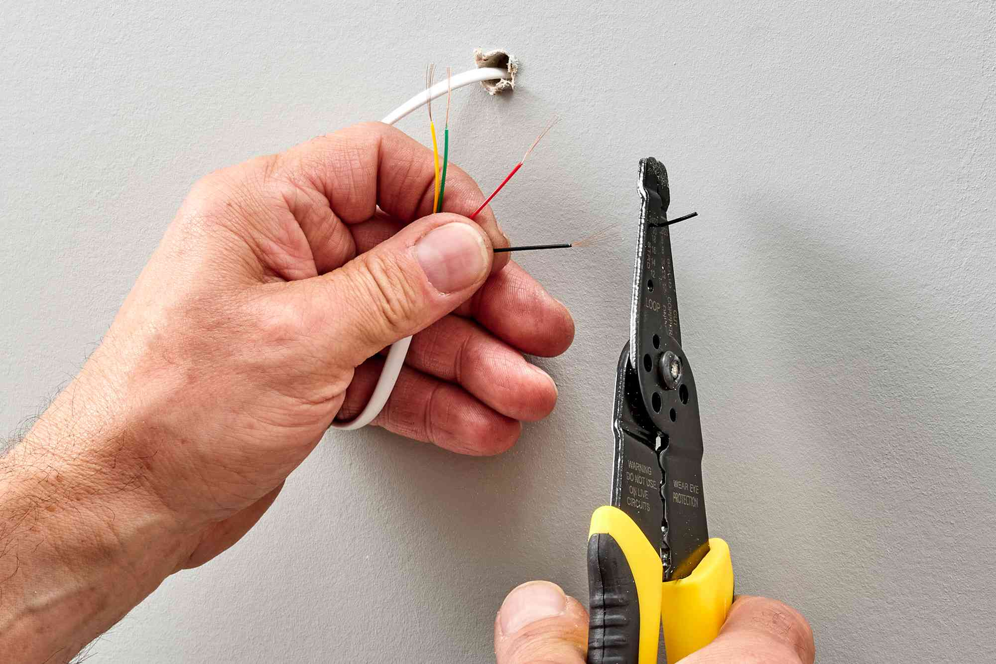 Individual wires untwisted and insulation stripped with wire strippers