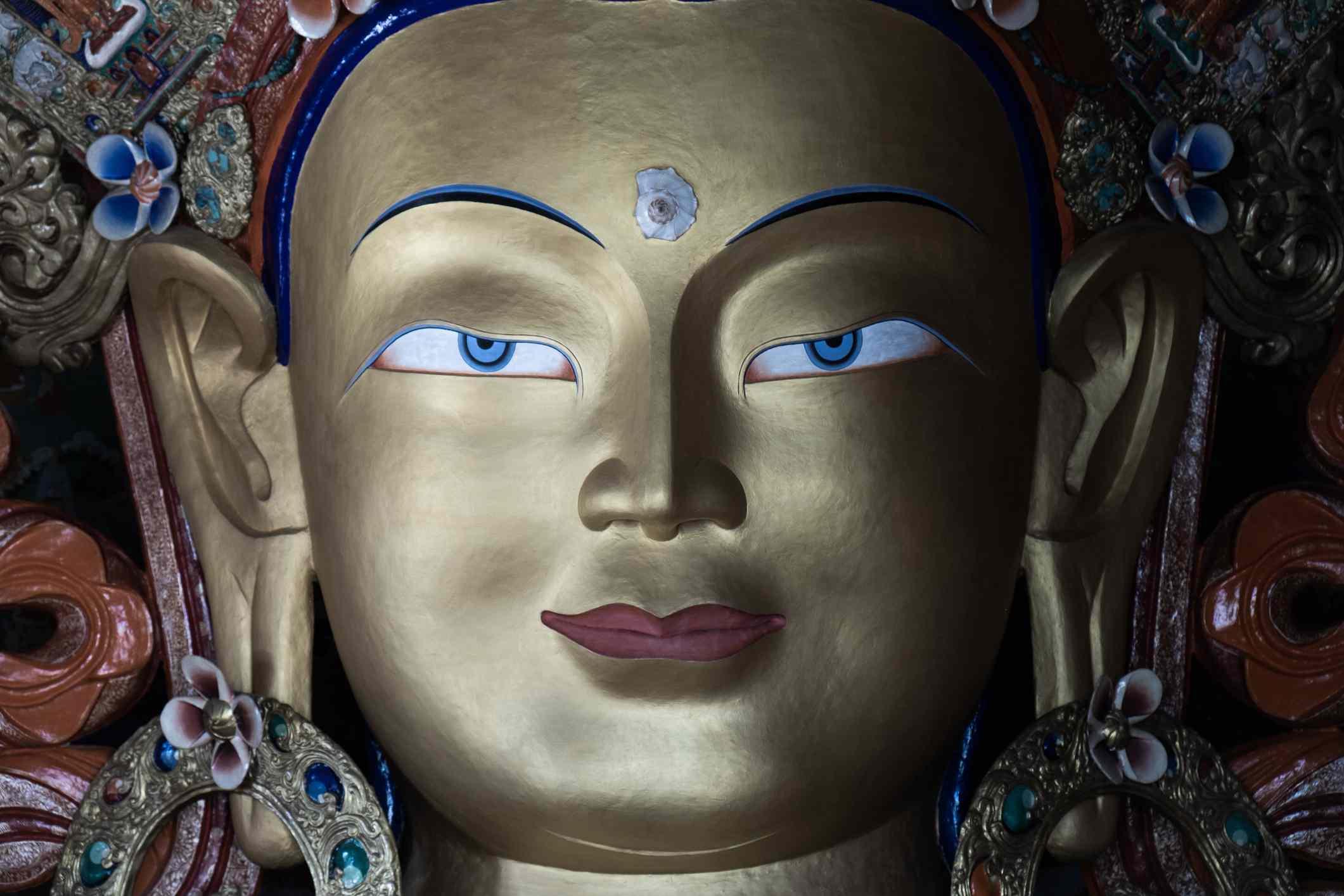 Close-up shot of Statue of Maitreya Buddha at Thiksey Monastery, Ladakh, India