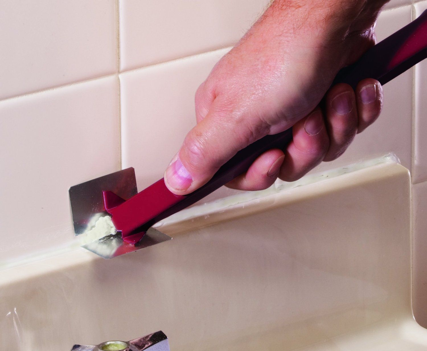 Caulk removal can be done using an inexpensive mechanical tool