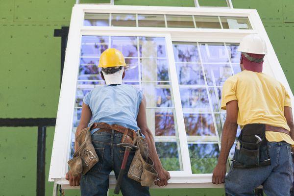 Carpenters installing window