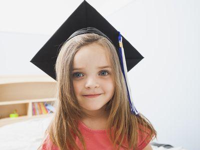 Caucasian girl wearing graduate cap