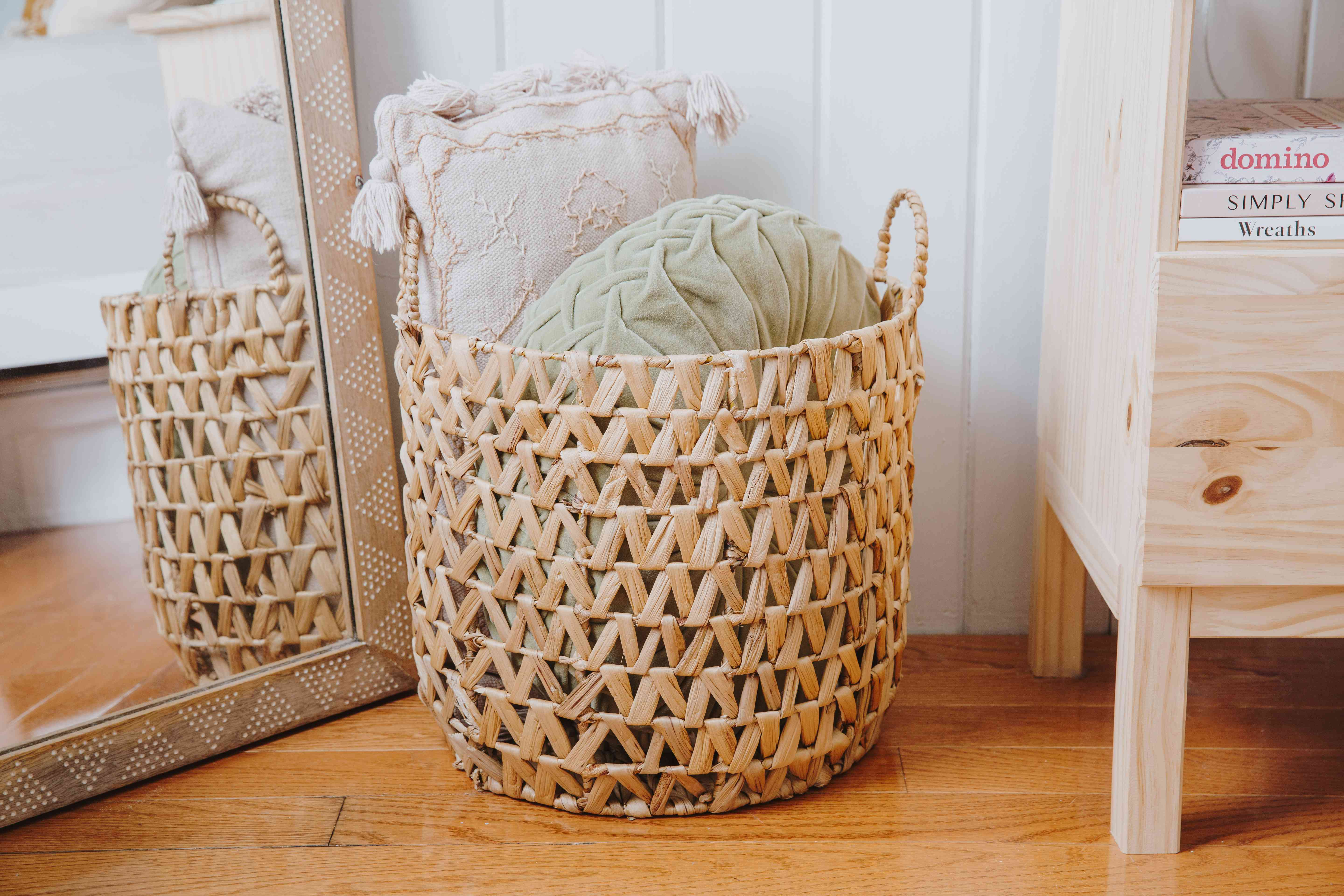 placing bed pillows in baskets