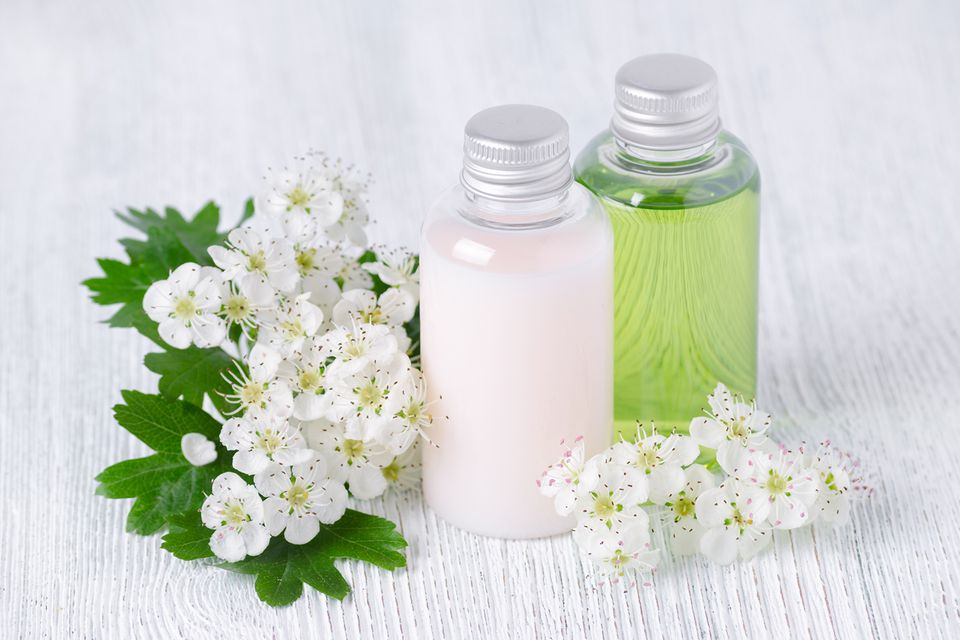 Natural Cosmetic Bottles With Fresh Flowers
