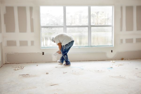Installing Drywall In a Room 155387955