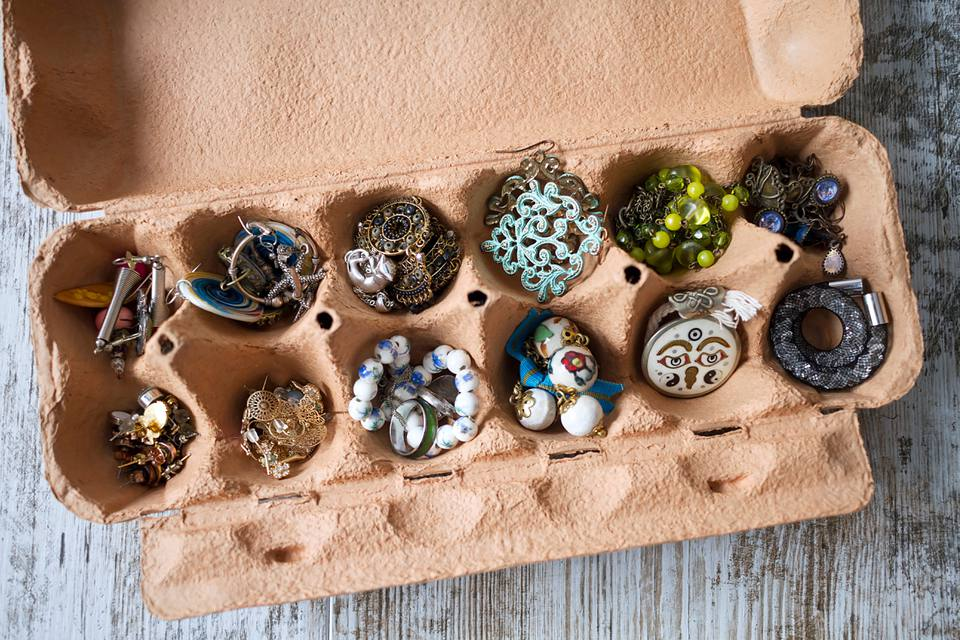 A recycled egg box used as organizer for jewelry