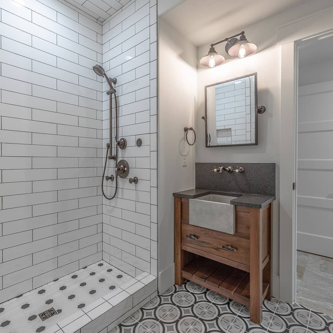 Bathroom with a vanity and cement sink