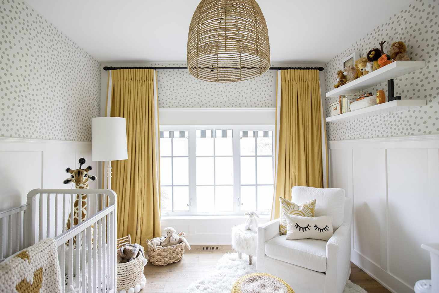 Neutral nursery with bold, mustard yellow accents.