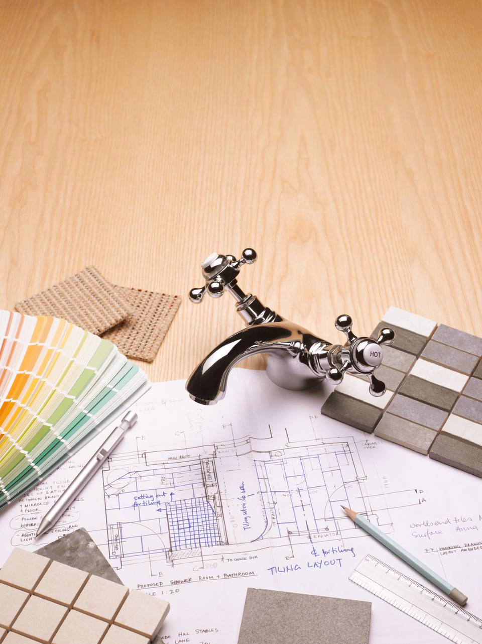 Paint and tile samples, faucet, and blueprints for bathroom