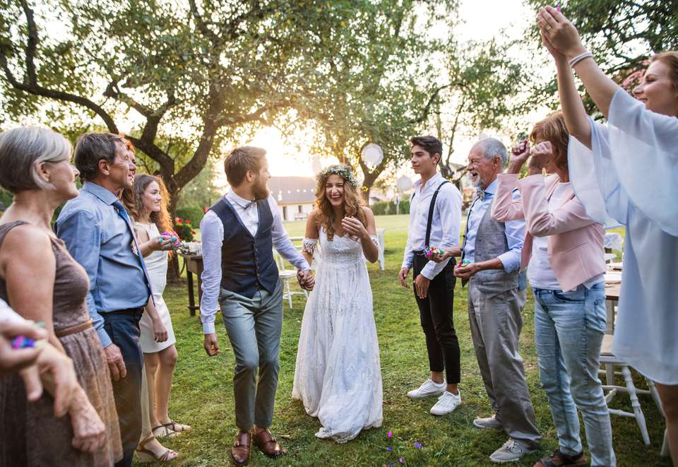 Bride and groom surrounded by guests
